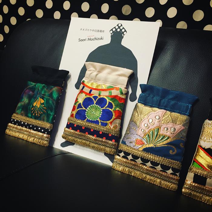 Saori Mochizukiの「オオズモウ 中目黒場所」化粧廻しポーチ・エアータニマチ